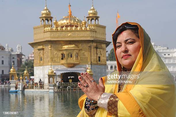 Indian actress and former Big Boss participant Dolly Bindra poses for a picture at the Sikh Shrine the Golden temple in Amritsar on February 1 2012...