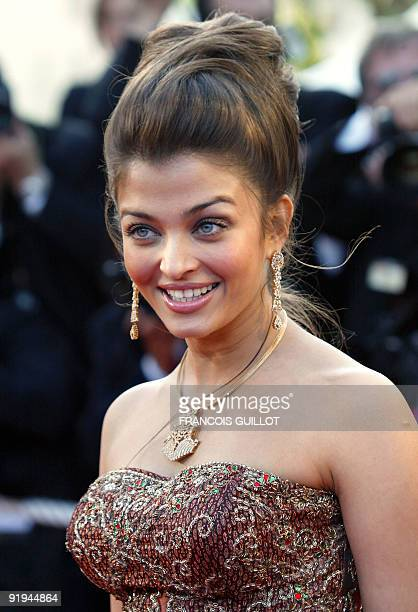 Indian actress and jury member Aishwarya Rai poses for photographers as she arrives at the palais des festivals to attend the screening of 'Les...