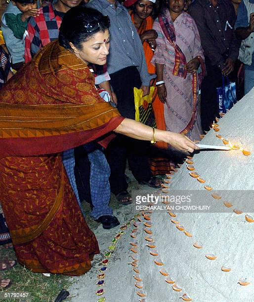 Indian actress Aparna sen lights candles during a vigil to mark the International Day to End Violence against Women and Girls in Calcutta 25 November...