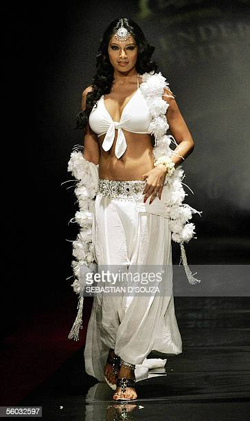 """Indian actress Bipasha Basu displays a creation by designer Rocky-S at the annual """"Blenders Pride Fashion Tour"""" in Mumbai late 29 October 2005. The..."""