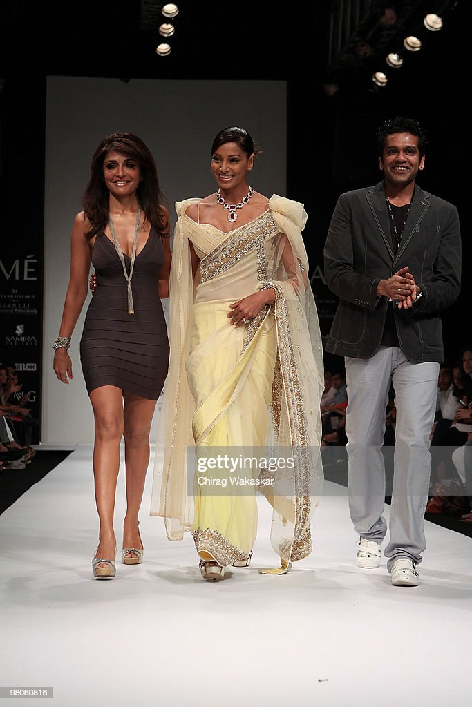 Indian actress Bipasha Basu walks the runway in an Giantti design along with fashion designers Queenie Rocky S at the Lakme India Fashion Week Day 1..
