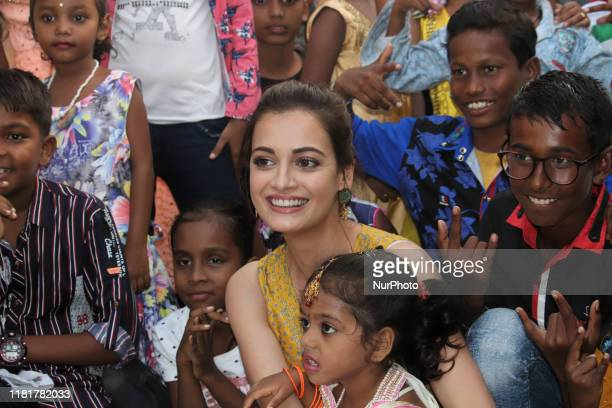 Indian actress Dia Mirza poses for a photograph with underprivileged children during the launch of an initiative 'Exceed Cares' in Mumbai, India on...