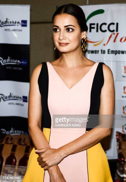 Indian actress Dia Mirza poses for photographs as she takes part in the event 'A step towards our environment' ahead of the World Environment Day...