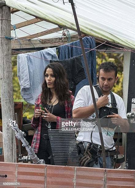 Indian actress Freida Pinto takes a break during the filming of the movie Blunt Force Trauma on October 8 near Choachi Cundinamarca deparment...