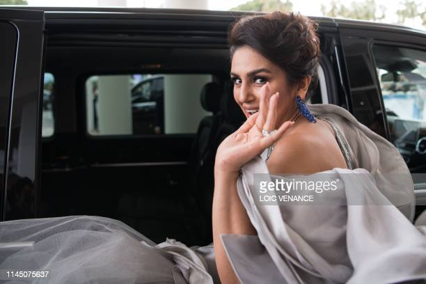 Indian actress Huma Qureshi waves as she leaves for the Festival Palace to attend the screening of the film A Hidden Life at the 72nd edition of the...