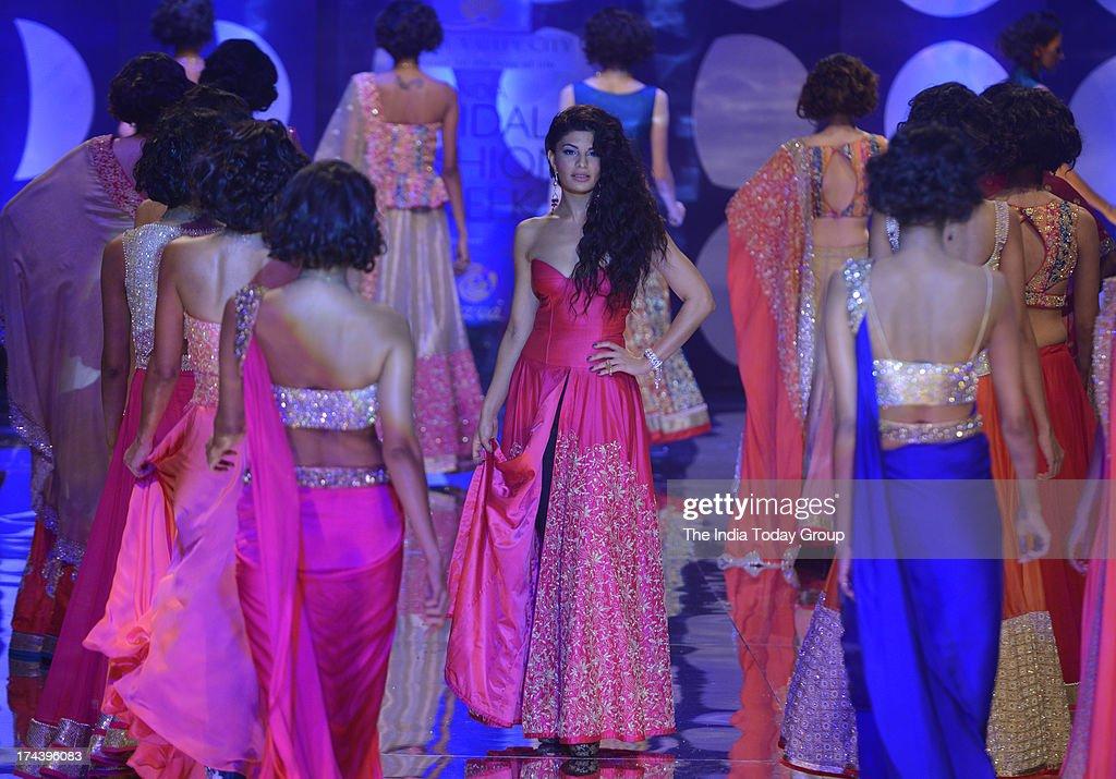 Indian actress Jacqueline Fernandez walks the ramp for designer Jyotsna Tiwari at the Aamby Valley India Bridal Fashion Week 2013