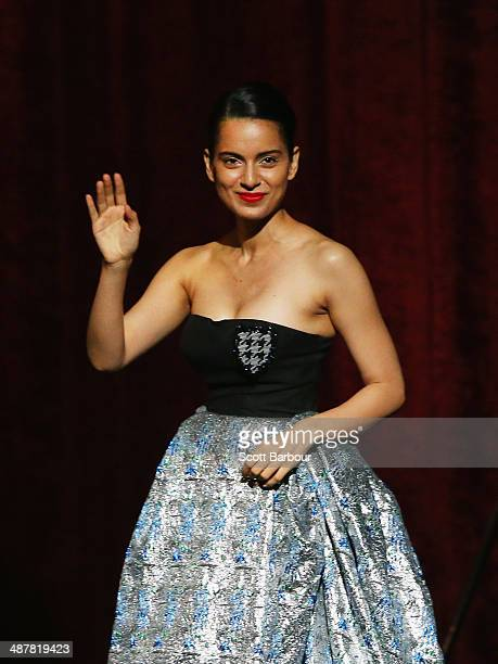 Indian actress Kangana Ranaut gestures as she walks on stage to accept her award at the Indian Film Festival of Melbourne Awards at Princess Theatre...