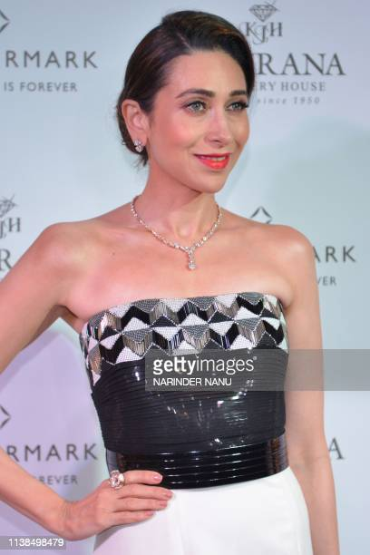Indian actress Karisma Kapoor poses for photographs during a promotional event for the jewellery brand 'Forevermark' launch at Khurana Jewellery...