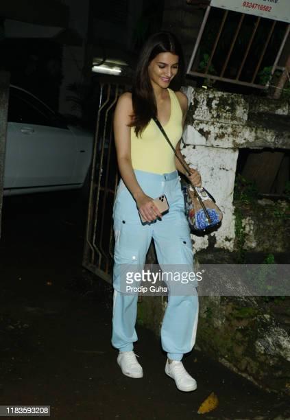Indian actress Kriti Sanon attends the Salon at Juhu on October 26 2019 in Mumbai India