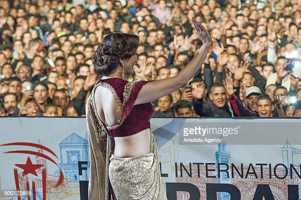 Indian actress Madhuri Dixit salutes the audiences during the 15th Marrakesh international film festival in Marrakesh Morocco on December 05 2015