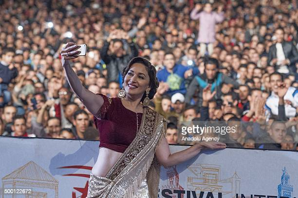 Indian actress Madhuri Dixit takes a selfie as she salutes the audiences during the 15th Marrakesh international film festival in Marrakesh Morocco...