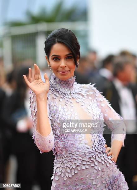Indian actress Mallika Sherawat waves as she arrives on May 10 2018 for the screening of the film 'Sorry Angel ' at the 71st edition of the Cannes...