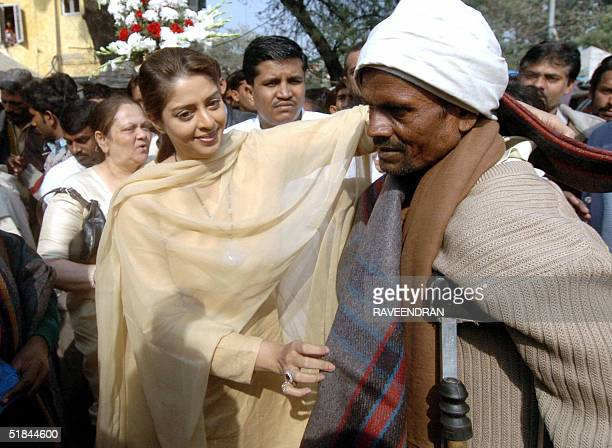 Indian actress Nagma distributes blankets to homeless people in an event to mark the International Human Rights Day in a New Delhi 10 December 2004...