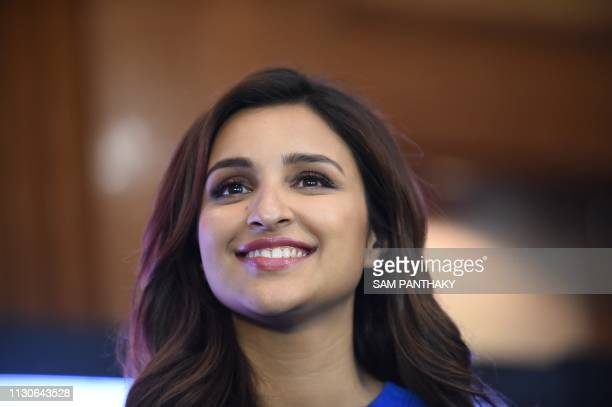 Indian actress Parineeti Chopra smiles during the promotion of the new Bollywood film 'Kesari' in Ahmedabad on March 15 2019 Indian actors Akshay...