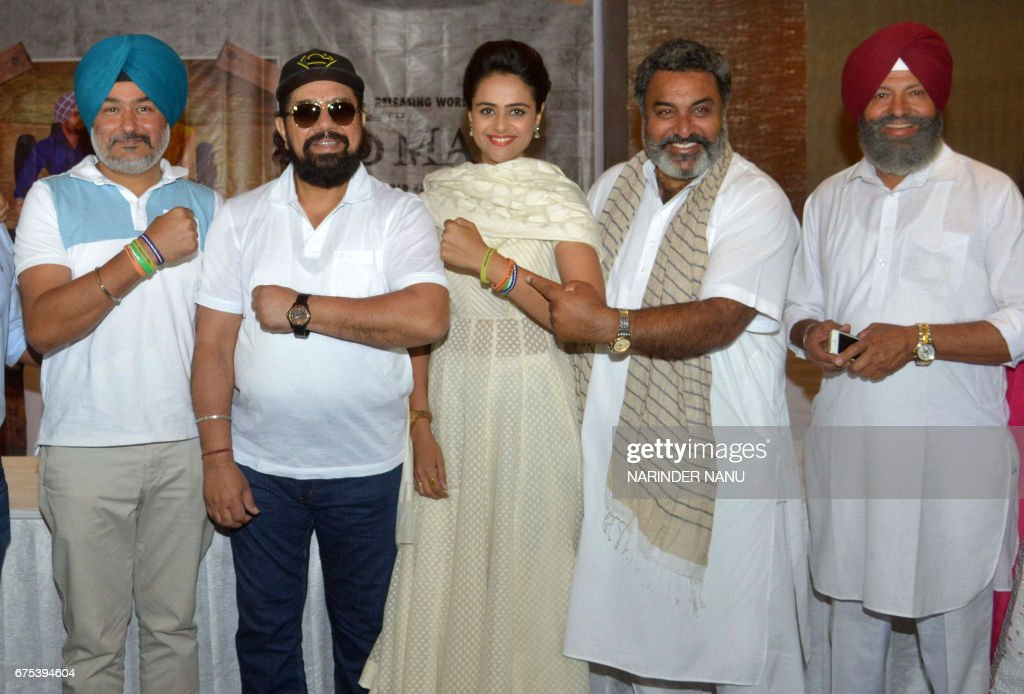 Indian actress Prachi Tehlan poses with actors BN Sharma Hobby Dhaliwal and Shivender Mahal along with director Manduip Singh at a promotional event..