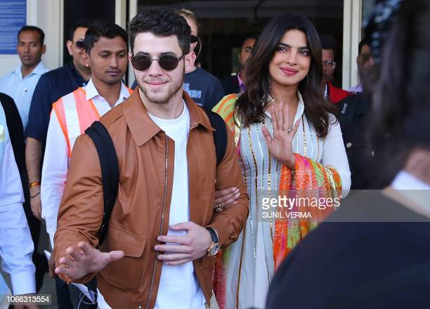 TOPSHOT Indian actress Priyanka Chopra and US musician Nick Jonas arrive in Jodhpur in the western Indian state of Rajasthan on November 29 2018...