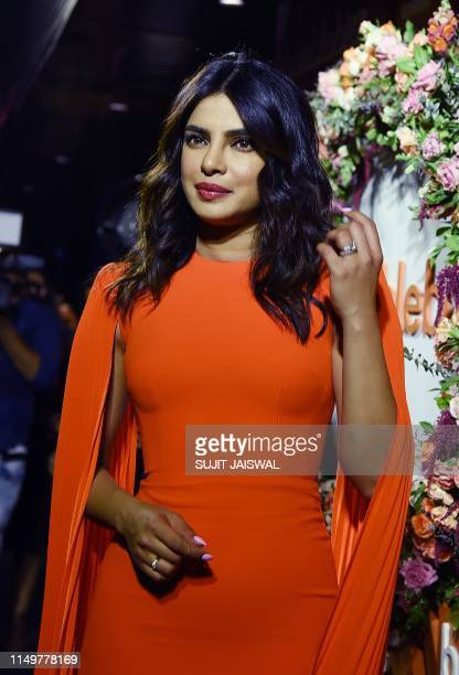 Indian actress Priyanka Chopra Jonas poses for a picture during the launch event of Bumble a social and dating application in Mumbai late on June 13...