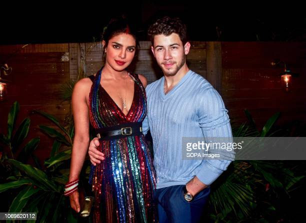 Indian actress Priyanka Chopra L with her husband US musician Nick Jonas R seen posing for a picture at Bumble's India launch party at Soho House...