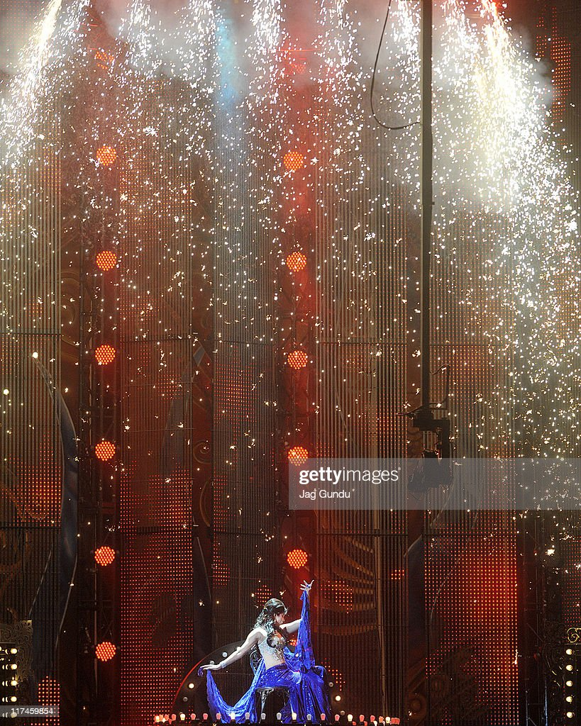 Indian actress Priyanka Chopra performs to pay tribute legedary singer Asha Bhosle during 2011 International Indian Film Academy (IIFA) awards at the Rogers Centron June 25, 2011 in Toronto, Canada.