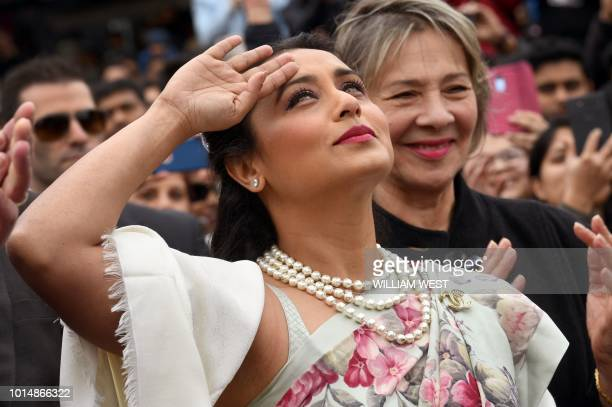 Indian actress Rani Mukerji salutes after unfurling the Indian flag in Federation Square at the Indian Film Festival of Melbourne on August 11 2018