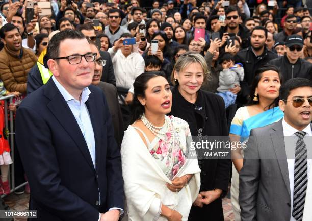 Indian actress Rani Mukerji sings the national anthem after unfurling the Indian flag with Victoria's Premier Daniel Andrews in Federation Square at...