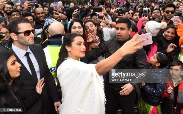 Indian actress Rani Mukerji takes a selfie with some of the thousands of fan in Federation Square at the Indian Film Festival of Melbourne on August...