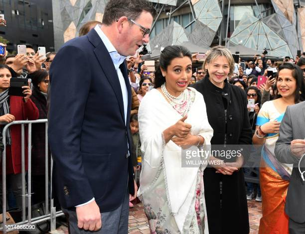 Indian actress Rani Mukerji unfurls the Indian flag with Victoria's Premier Daniel Andrews in Federation Square at the Indian Film Festival of...