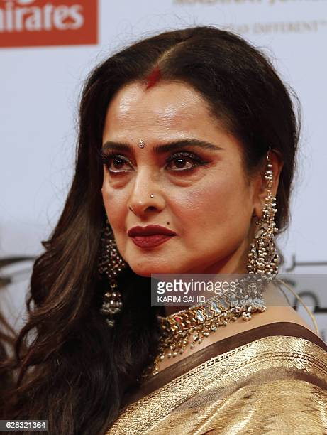 Indian actress Rekha attends the Opening Night Gala ceremony of the 13th Dubai International Film Festival , on December 7, 2016. / AFP / KARIM SAHIB