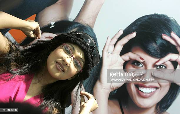 Indian actress Rituparna Sengupta poses with a pair of Titan spectacles after inaugurating a showroom namely Titan Eye in Kolkata on August 6 2008...