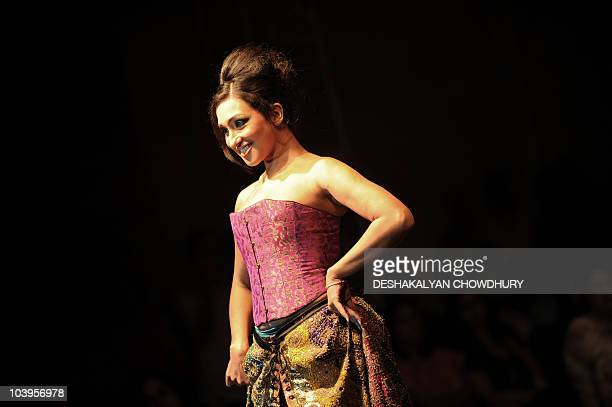 Indian actress Rituparna Sengupta showcases a creation of Indian designer Neeta Lulla during a fashion show in Kolkata on late September 9 2010 Many...