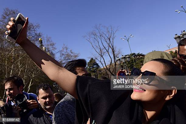 Indian actress Sonakshi Sinha takes a sefie with her fans during a Bollywood flashmod in Madrid on March 13 2016 Indian actors took place in a...