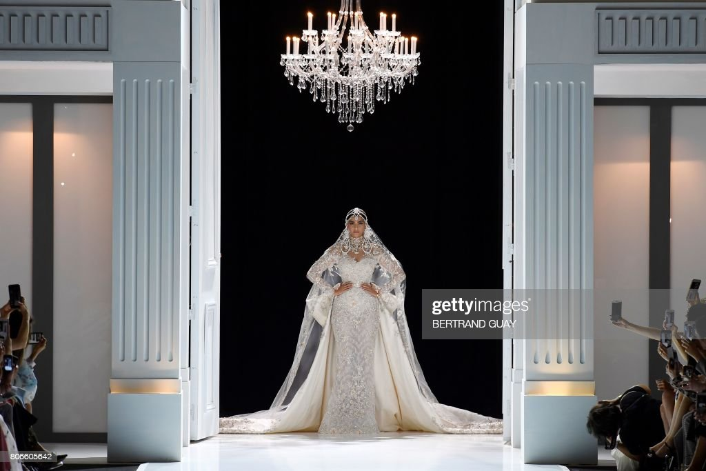 TOPSHOT - Indian actress Sonam Kapoor presents a creation by Ralph and Russo during the 2017 fall/winter Haute Couture collection in Paris on July 3, 2017. / AFP PHOTO / bertrand GUAY