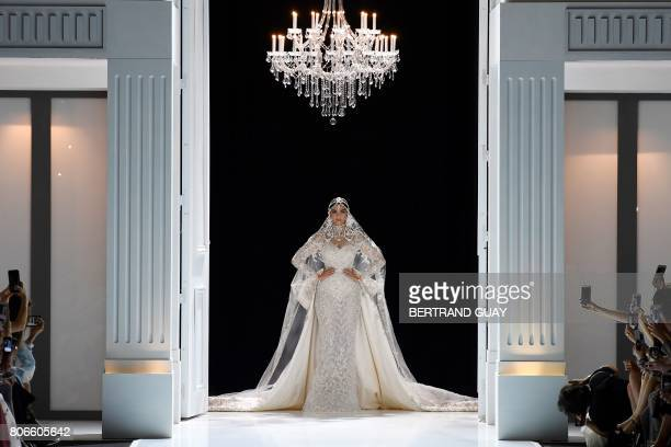 TOPSHOT Indian actress Sonam Kapoor presents a creation by Ralph and Russo during the 2017 fall/winter Haute Couture collection in Paris on July 3...