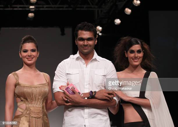 Indian actress Urvashi Sharma walks the runway with fashion designer Swapnil Shinde model Amrit Maghera at the Swapnil Shinde show at Lakme Fashion...