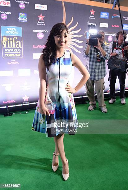 Indian actress Yami Gautam poses on the green carpet at the Tampa Convention Center ahead of IIFA Rocks on the second day of the 15th International...