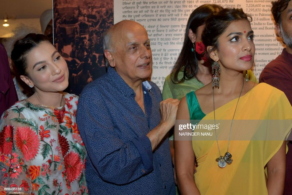 Indian actresses Gauhar Khan and Pallavi Sharda pose with film producer Mahesh Bhatt during a promotional event for the Bollywood film `Begum Jaan`...