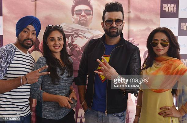 Indian actresses Keeya Khanna and Bhanushree , and Punjabi singers and actors Navraj Hans and Jarnail Singh pose for a photograph during a...