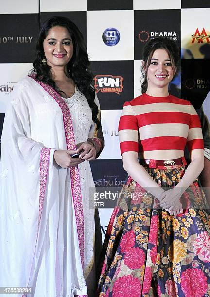 Indian actresses Tamannaah Bhatia and Anushka Shetty attend the trailer launch of their upcoming film 'Baahubali' in Mumbai late on June 1 2015 AFP...