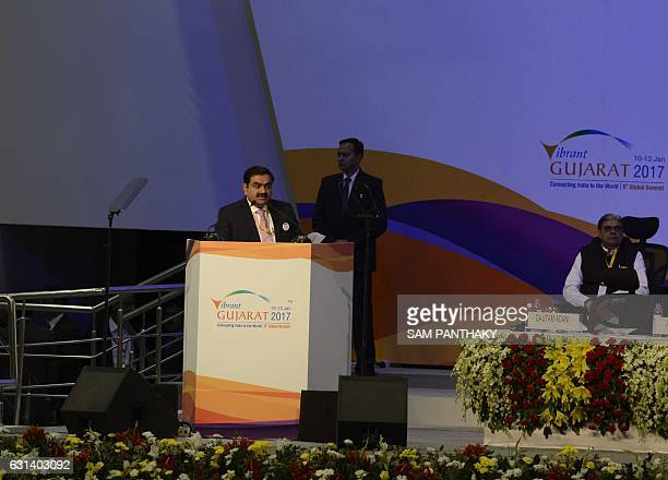 Indian Adani Group Chairman Gautam Adani addresses the Vibrant Gujarat Global Summit 2017 in the Indian city of Gandhinagar on January 10 2017 / AFP...