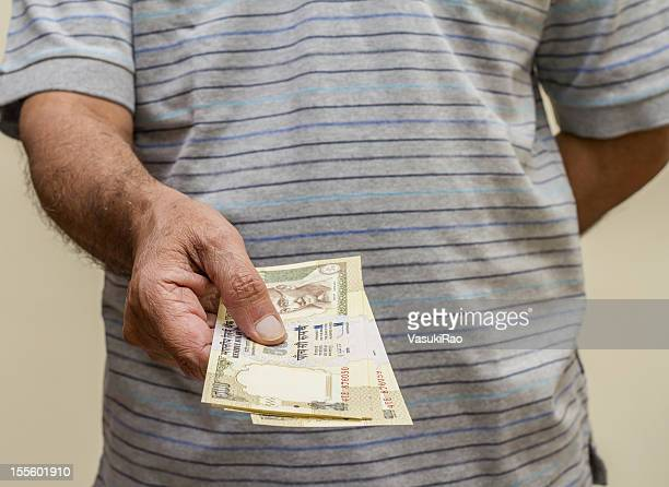 Indian adult making payment