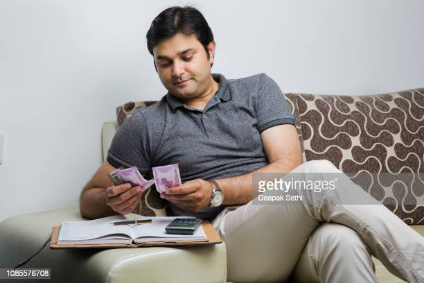 indian adult man - stock images - wages stock pictures, royalty-free photos & images