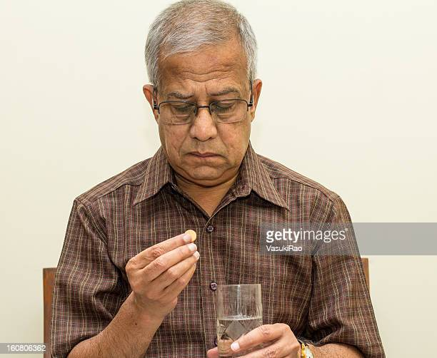 Indian adult taking pill