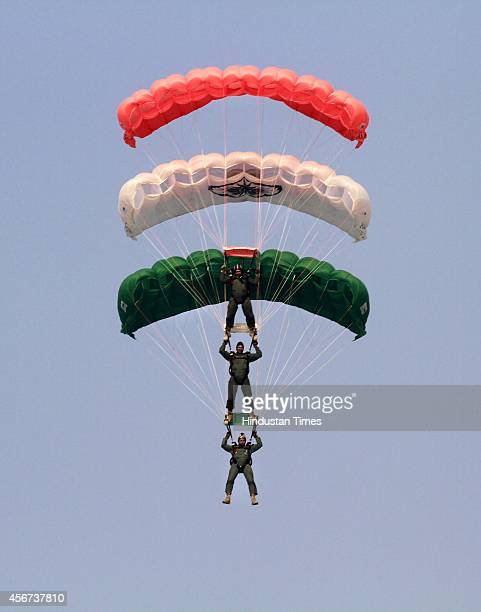 Indian Air Force Akash Ganga paratroopers form Tricolour combination as they glide to land during the full dress rehearsal for the Air Force Day at...