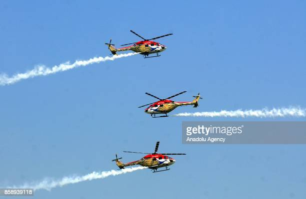 Indian Air Force ALH team perform a manoeuvre during the Air Force Day parade at the Hindon Air Force Station in Ghaziabad on the outskirts of New...