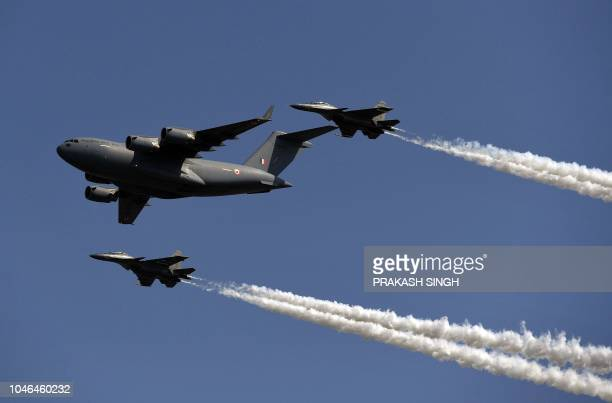 Indian Air Force C17 Globemaster Transport aircraft and two Sukhoi Su30MKI fighter jets fly past during a full dress rehearsal for the Air Force Day...