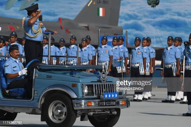 Indian Air Force Chief Air Chief Marshal Rakesh Kumar Singh Bhadauria inspects the IAF contingent during the Air Force Day parade at an IAF station...