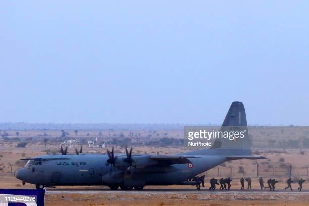 Indian Air Force commandos participate in a drill during an Indian Air Force excercise named ' Vayu Shakti2019' at the Air Force firing range of...