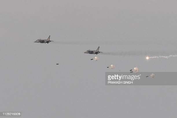 Indian Air Force fighter aircrafts fire missiles on dummy targets during the IAF 'Yayu Shakti' fire power demonstration at Pokharan in the Rajasthan...