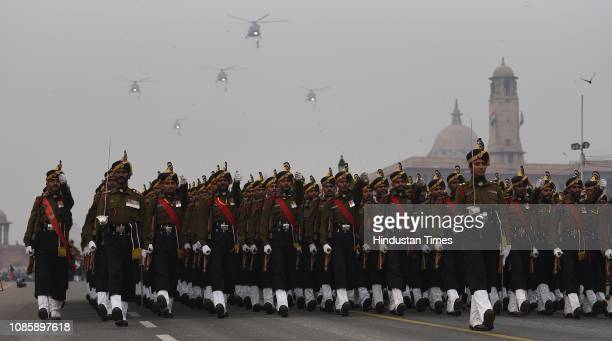 Indian Air Force helicopters fly over Rajpath as army personnel march during the rehearsals ahead of the Republic Day parade 2019 at Vijay Chowk on...