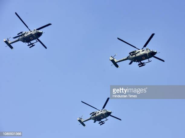 Indian Air Force helicopters fly over Rajpath during the rehearsals ahead of the Republic Day Parade on January 20 2019 in New Delhi India